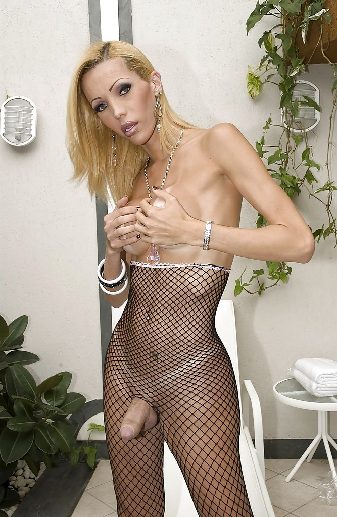Beautiful Blonde Transexual Renata Davilla Poses Solo In Fishnet Bodysuit