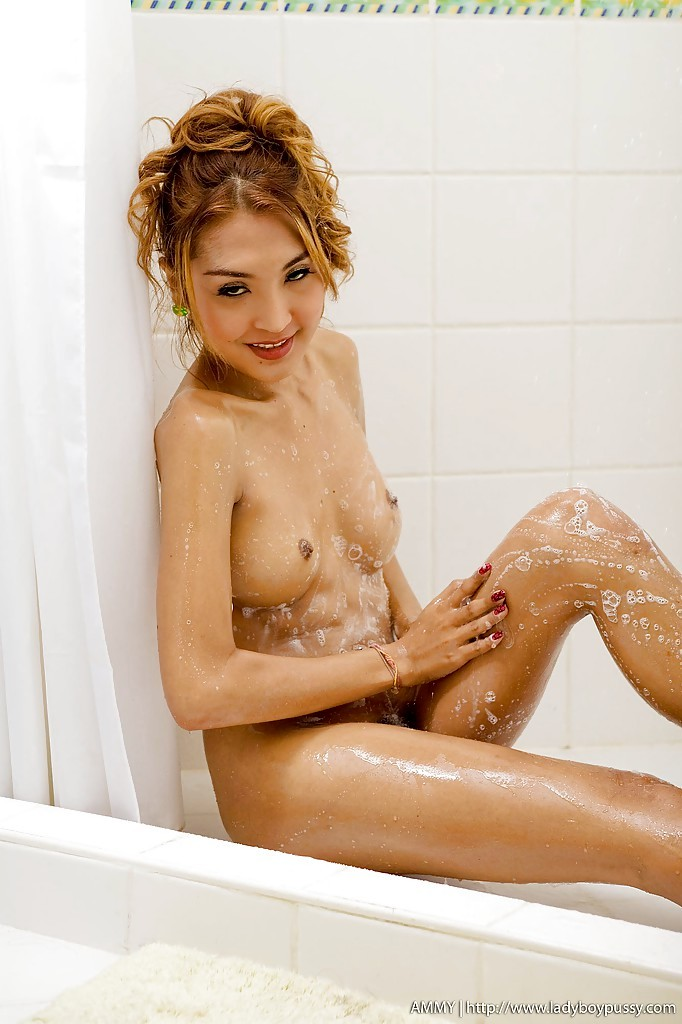 Beautiful Thai Transexual Ammy Taking A Bath And Spreading Her Provocative Pussy