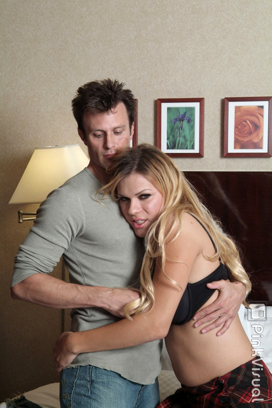 Blonde Shemale Jesse Rubbing Her Meaty Penis Up Against A Man's Dick