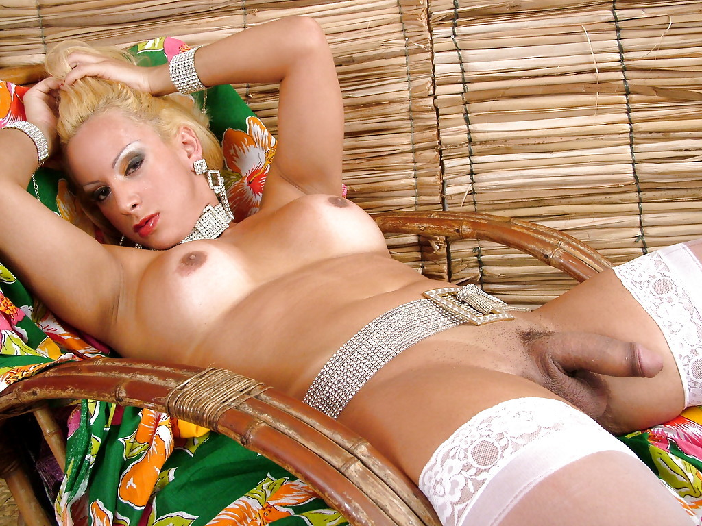 Blonde Solo T-Girl Richelly Prins Flaunting Enormous Juggs And Bum In Stockings