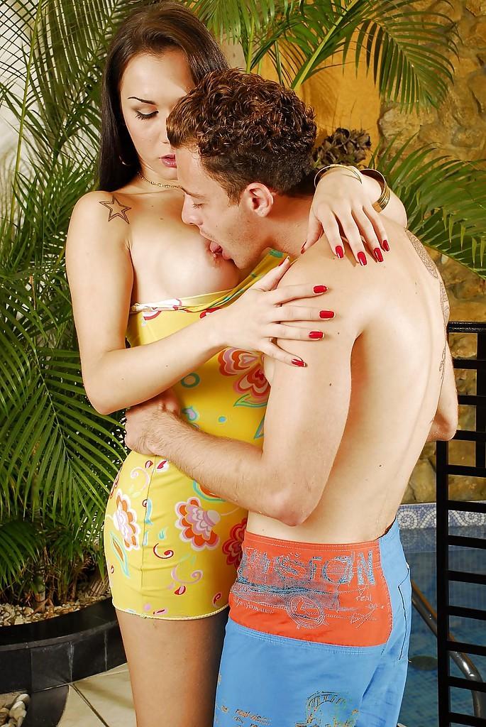 Busty Brunette Ladyboy Kalenda Rios Sucking Dick On A Massive Dick Poolside