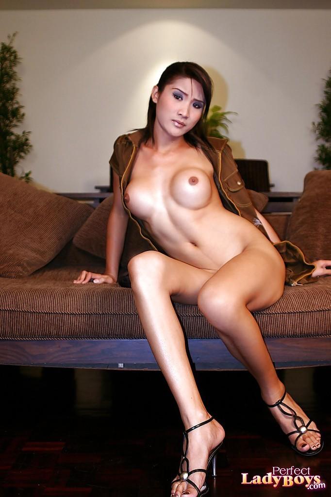 Busty Brunette Thai Ladyboy Tinna Spreading Her Legs In High Heels