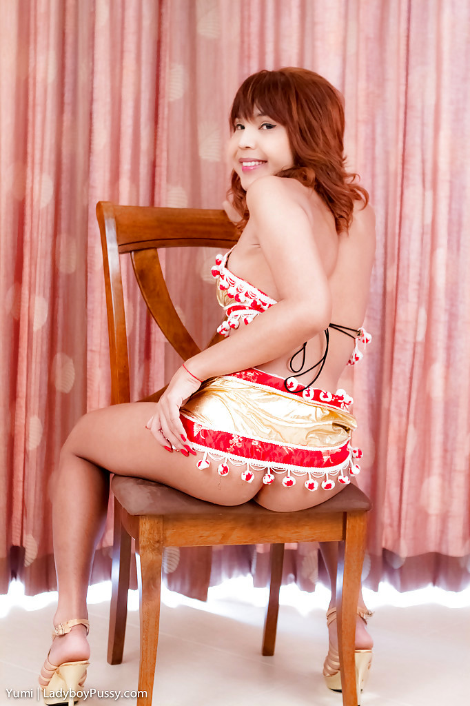 Cute Asian T-Girl Yumi Posing On A Chair And Spreading Her Inviting Pussy