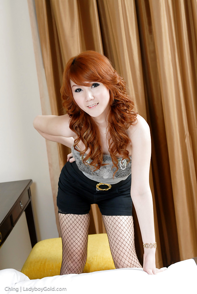 Cute Redhead Thai Ladyboy Ching Stripping And Jerking In Stockings