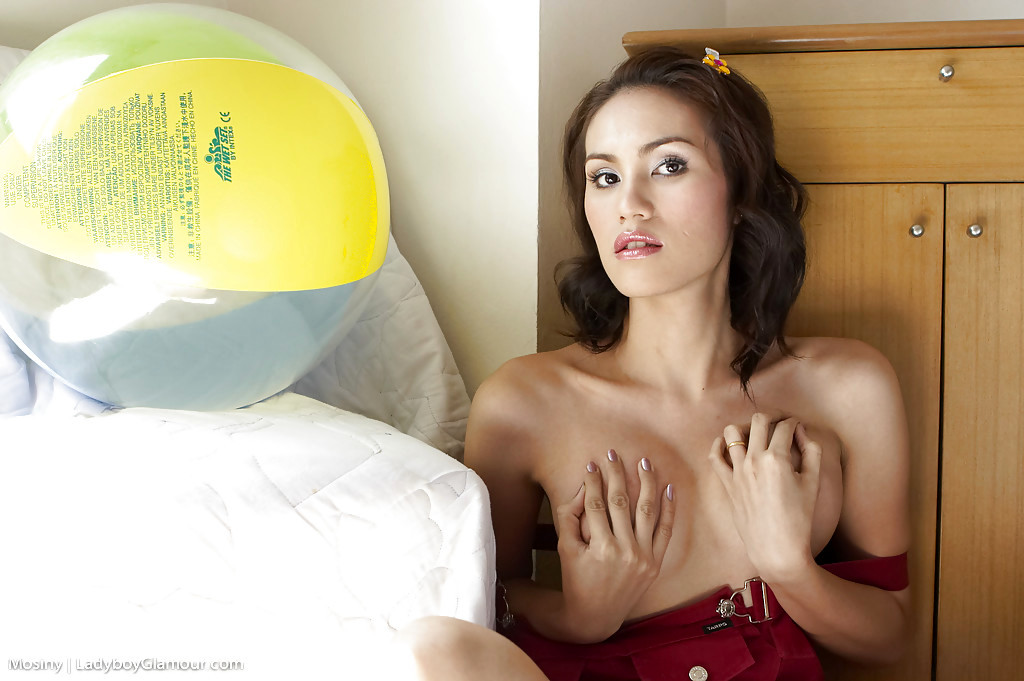 Cute Thai Tgirl Mosiny Spreading And Jerking With A Tennis Racket