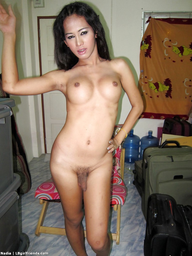 Filthy Asian TGirl Nadia Playing With Her Massive Breasts In Public And Spreading