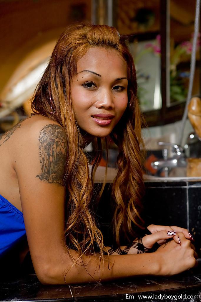Kissable Thai Femboy Em Poses Tattooed Body In Long Socks And High Heels