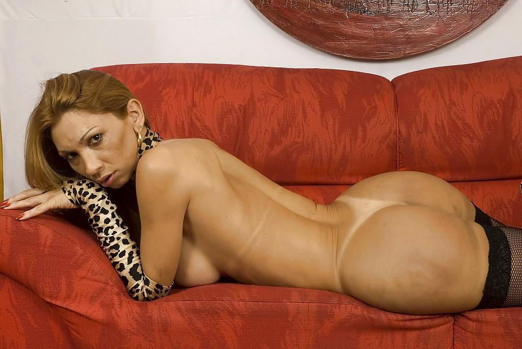 Large Breasted Mature Latina Femboy Raquel Dorado Posing In Flirtatious Lingerie