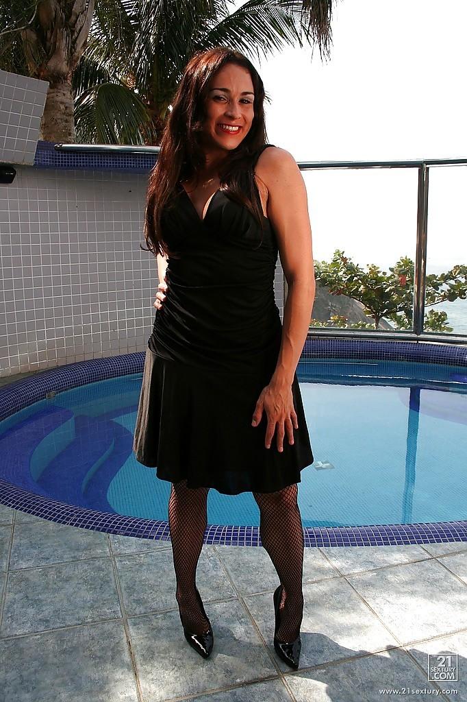 Massive Boobed Brazilian T-Girl Suzy Tran Stripping Down To Fishnet Stockings