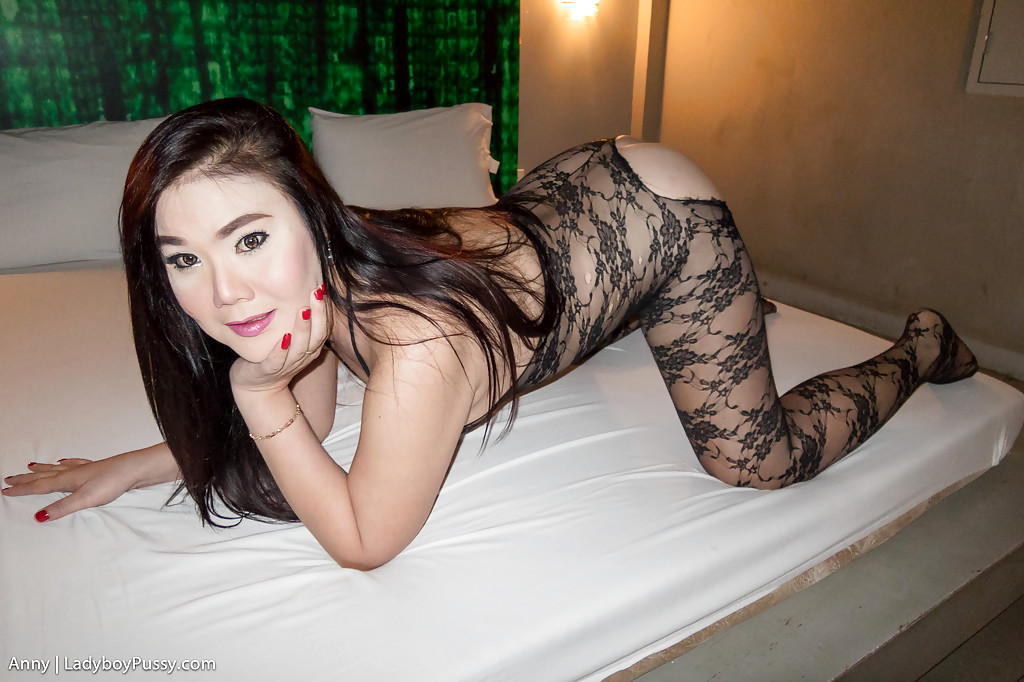 Nasty Thai Tranny Anny Posing And Rubbing Her Arousing Pussy On A Bed