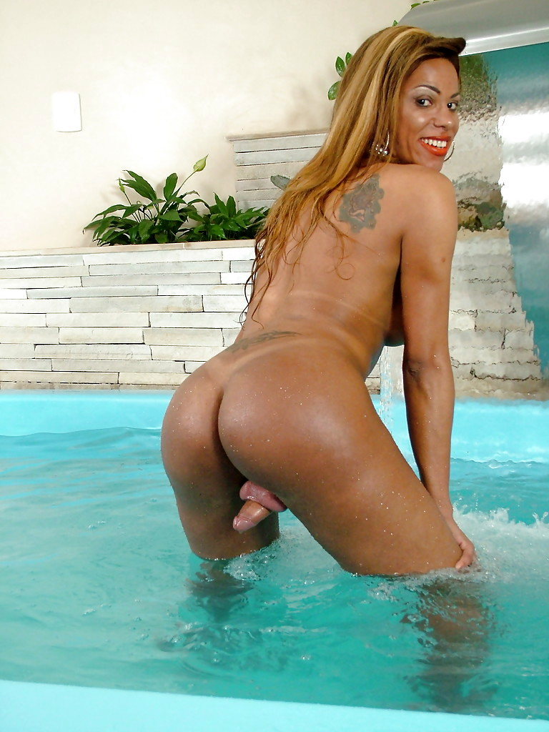 Nerdy Ebony TGirl Ester And Her Massive Breasts Pose Topless In Pool