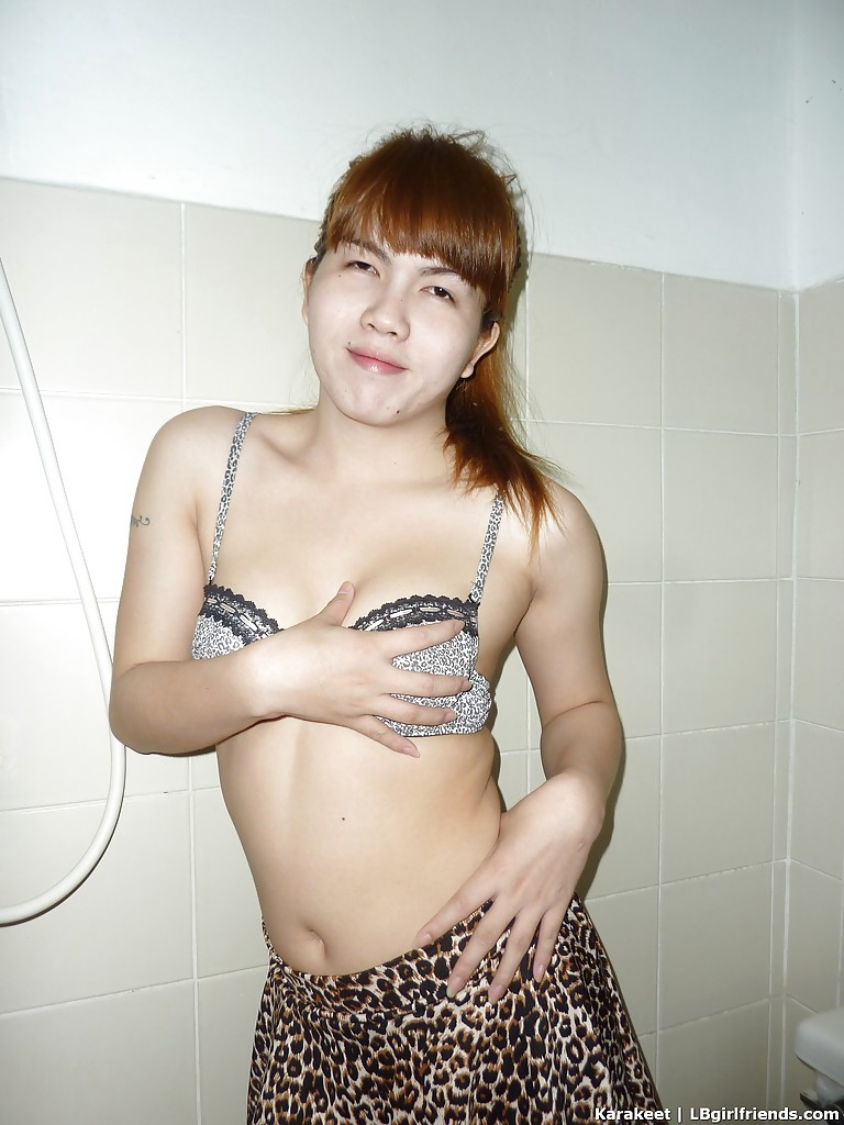 Redhead Thai Ladyboy Pulls Out Petite Dick For Wanking After Stripping Naked