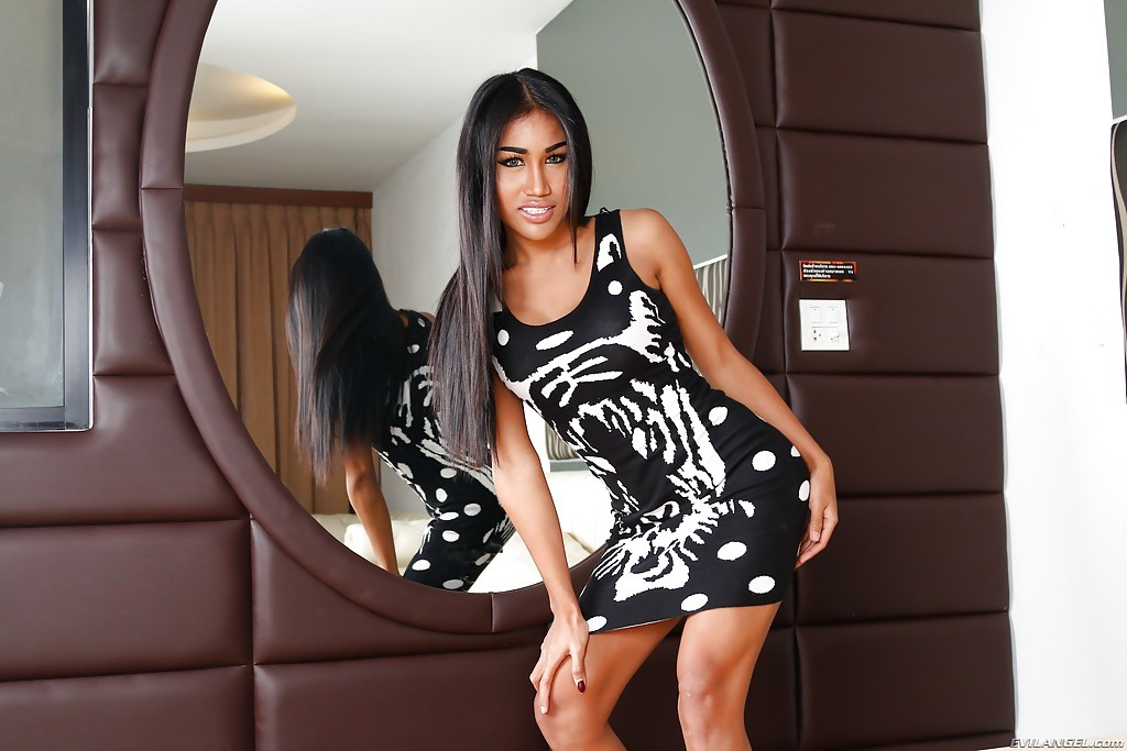 Sensuous Thai Tranny Alisa C Posing Fully Clothed Before Stripping Naked