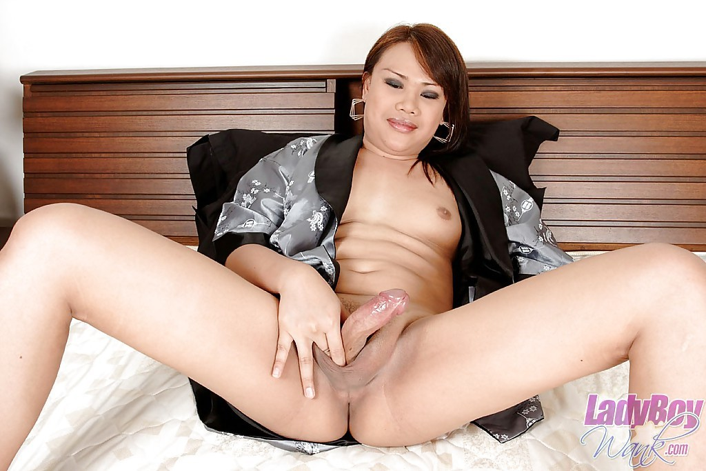 Shaved Brunette Asian T-Girl Dao Playing With Her Butt And Penis