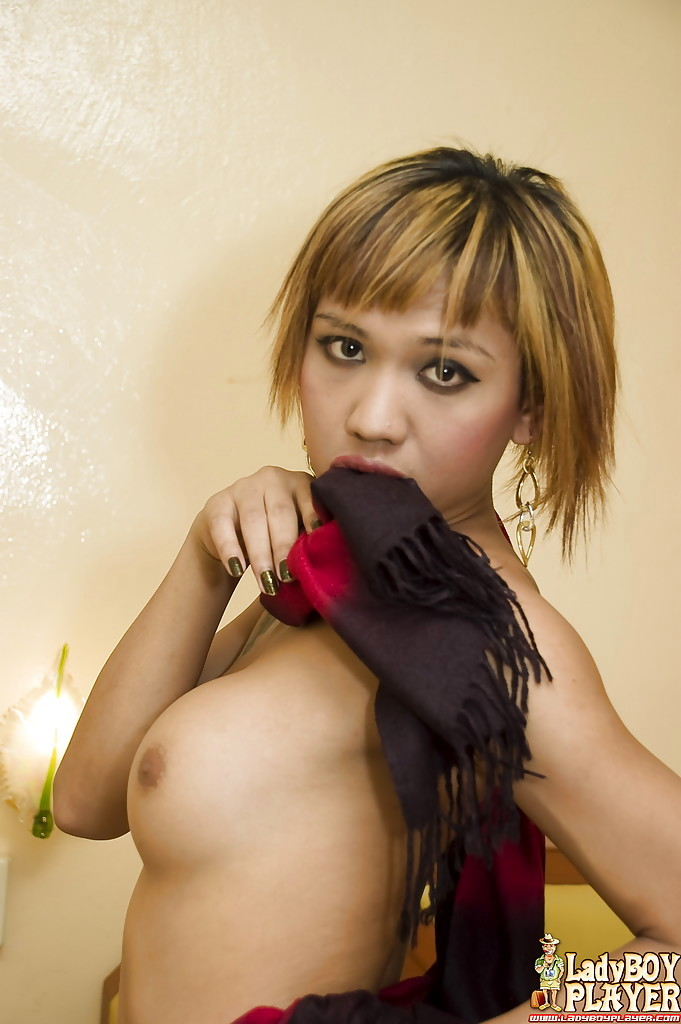 Short Haired Thai T-Girl Yoyo Showing Off Enormous Boobs And Shaved Shecock
