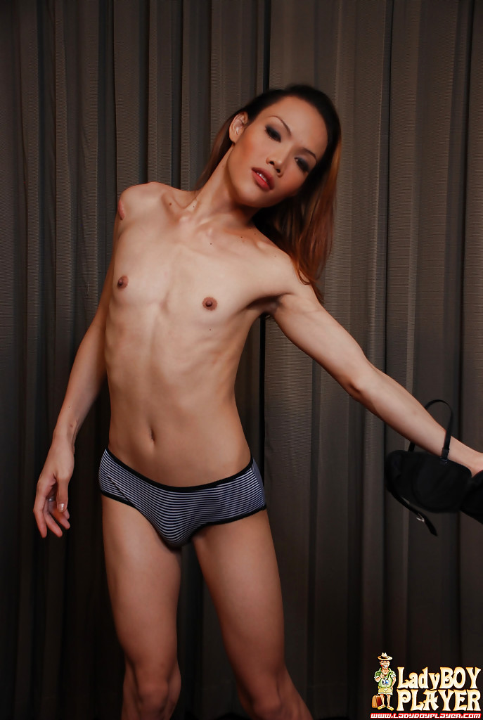 Slender Redheaded Thai TGirl Joy Baring Flat Chest And Enormous Hairy Shecock