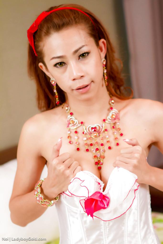 Slim Thai TGirl Noi Toying Bum In Pink Stockings And Garter