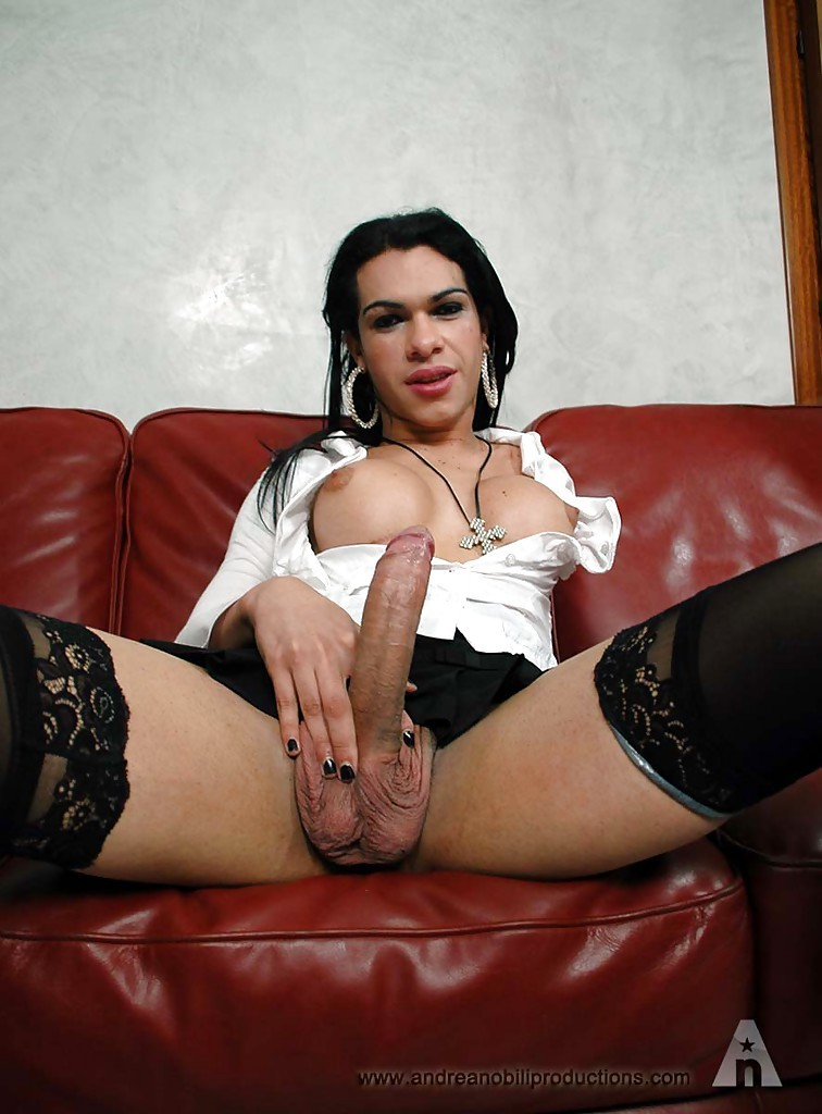 Slutty Brunette T-Girl With Enormous Breasts Butt Banging On A Red Sofa