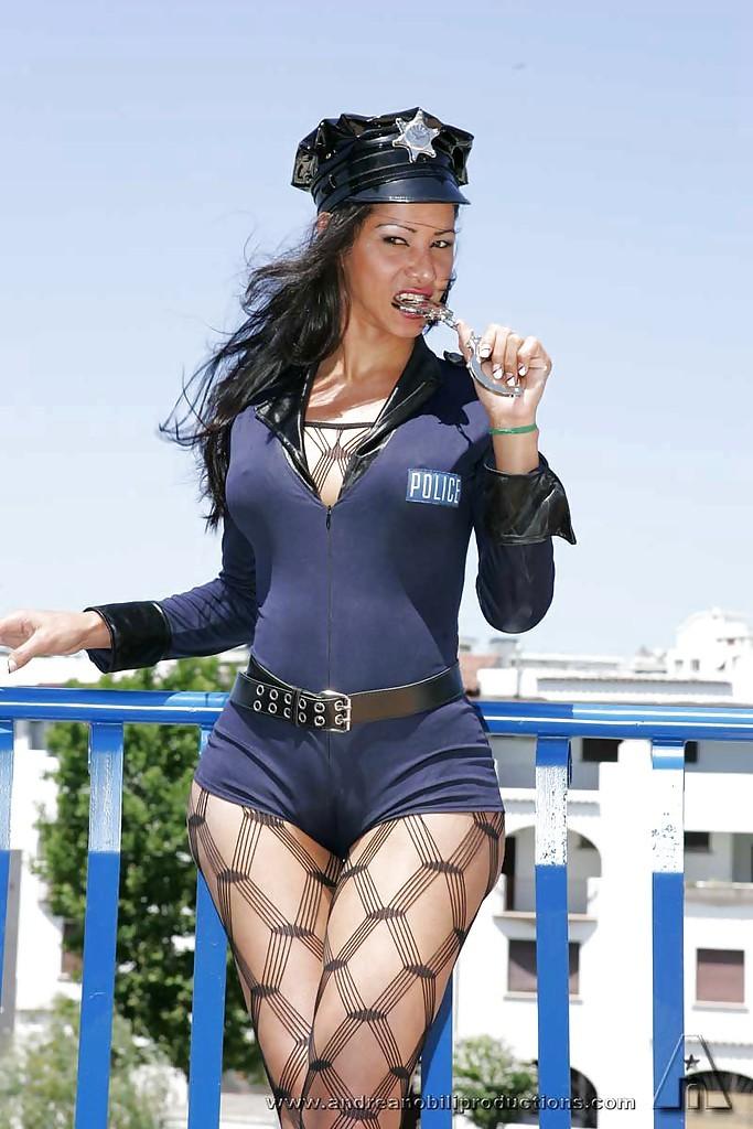 Slutty Brunette Transexual In A Cop Uniform Enjoying A Kinky Threesome