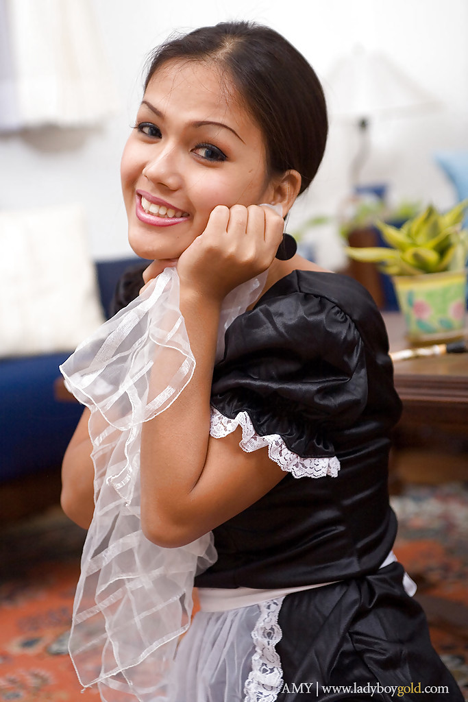 Slutty Thai Tranny Amy Posing In A Arousing Maid Costume Spreading Her Legs