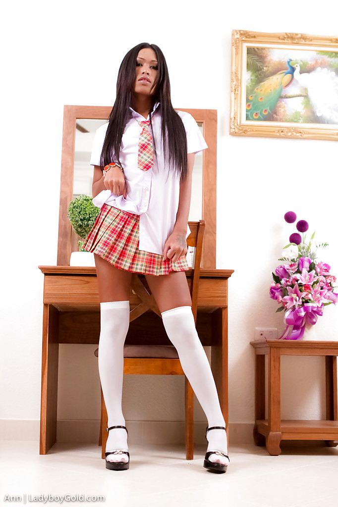 Small Femboy Ann Poses Solo In Knee High White Socks And Pleated Skirt