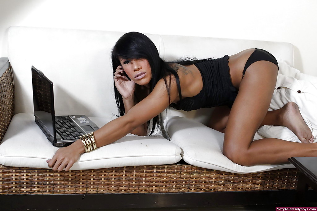 Splendid Brunette Thai Shemale Showing Off Her Hairless Butt