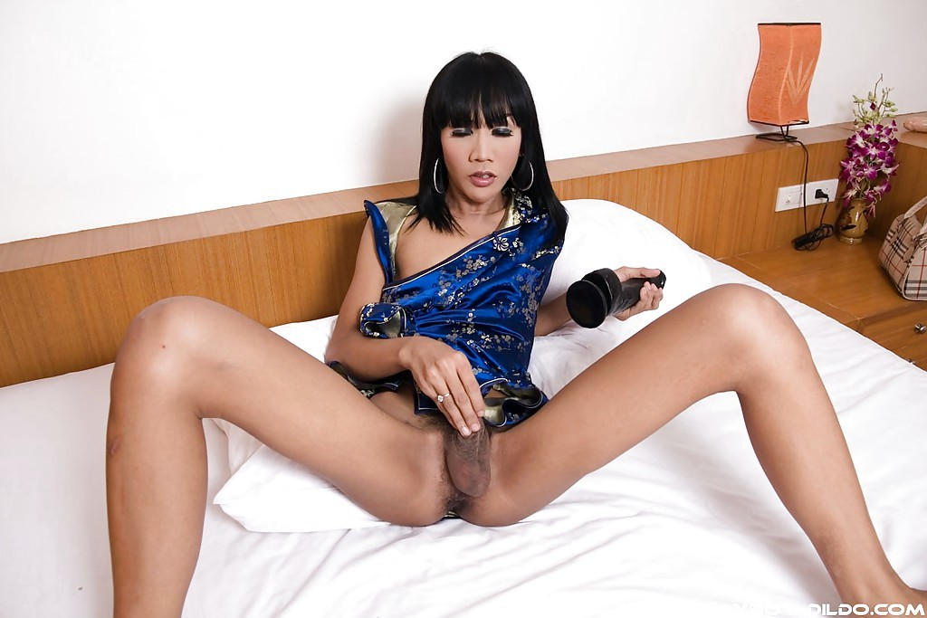 Thin Black Haired Thai Transexual May Playing With Her Enormous Vibrator And Penis